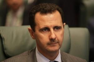 Syrian President Bashar al-Assad attends